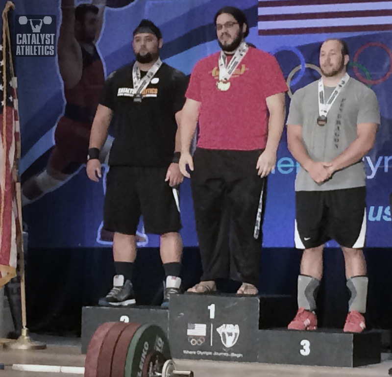 Brian Wilhelm (left) winning the silver medal in the 105+ kg category