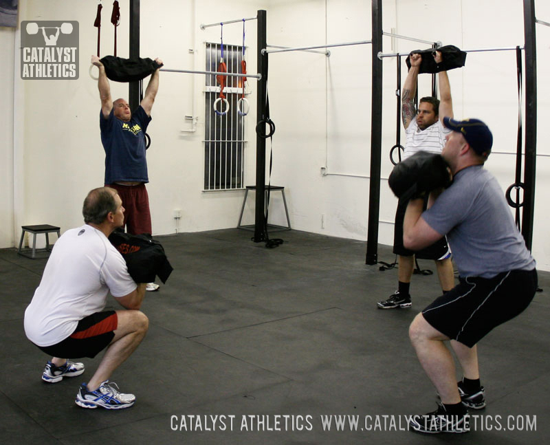Sandbag clean + push press workout - Catalyst Athletics