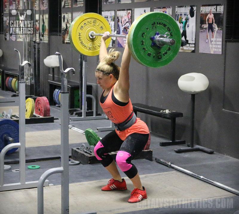 3x3 Powerlifting Program: Low Rep Strength--woman in orange tank powerlifting